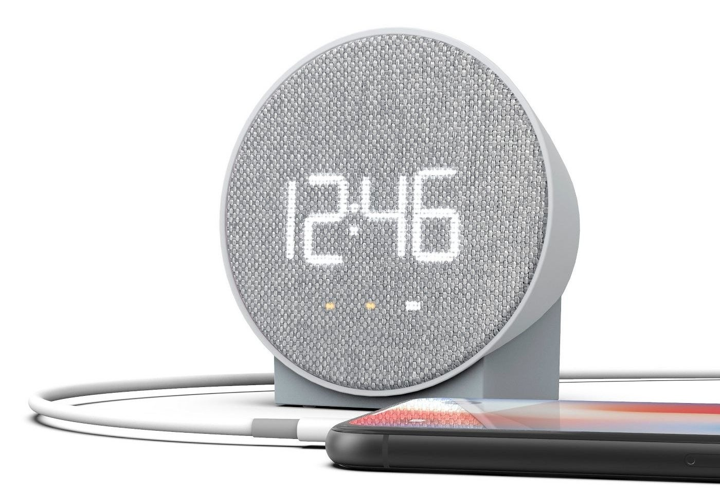 A small grey digital alarm clock