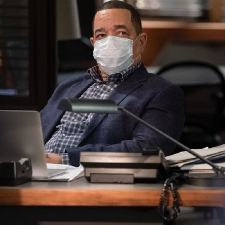 "Ice-T from ""Law And Order: SVU""; he is sitting in his office, wearing a mask"