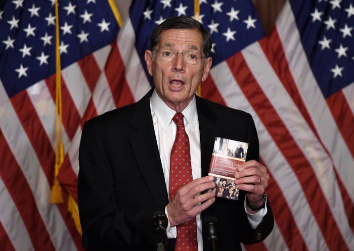 Barrasso holds up a copy of the US Constitution