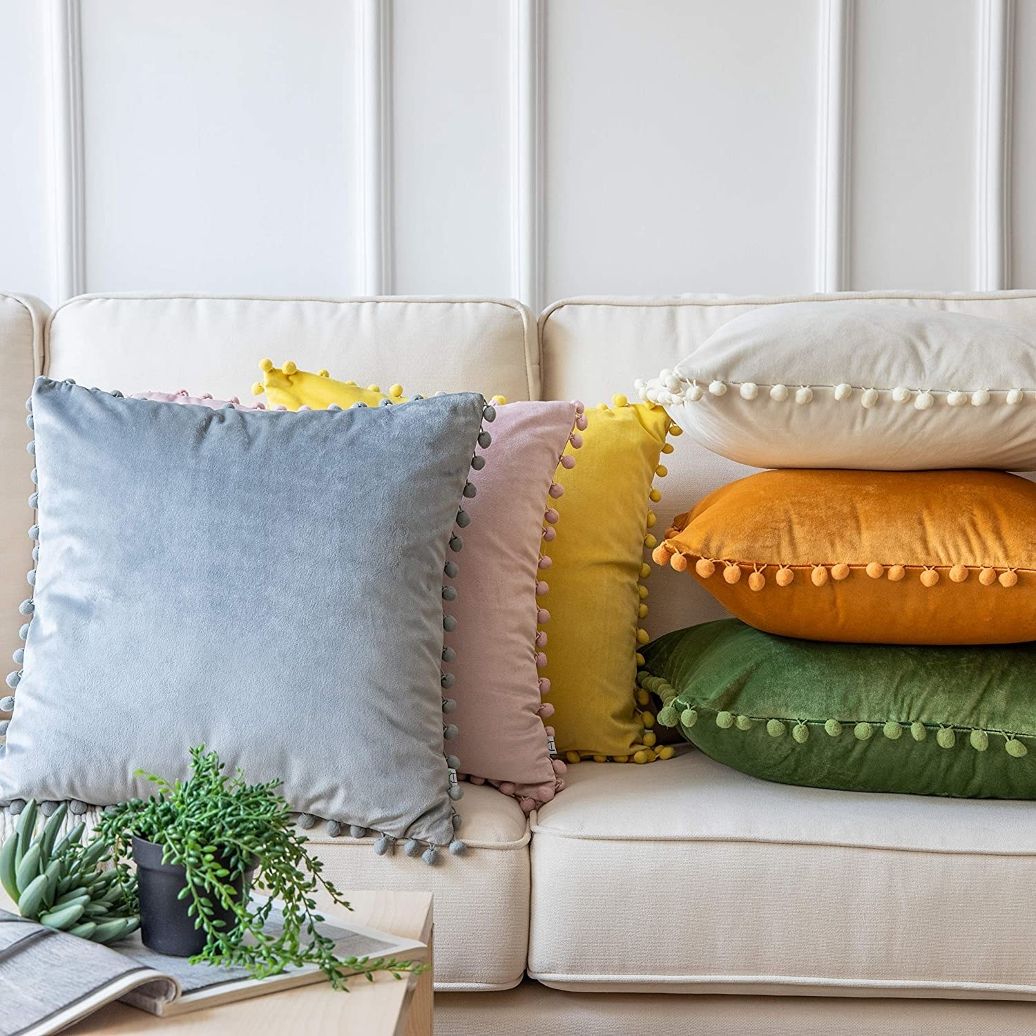 stack of velvet pillows on a couch