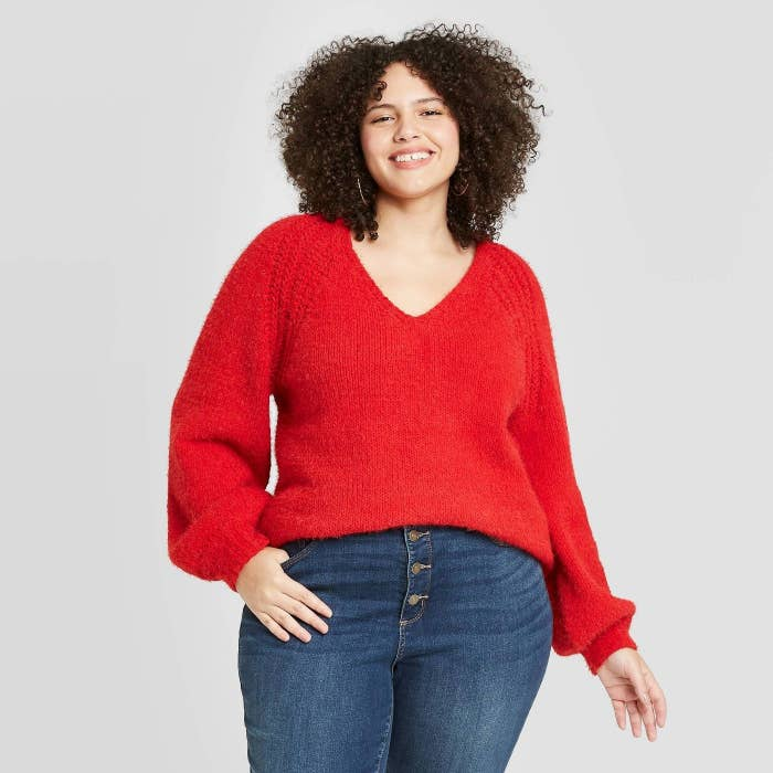 Model in red v-neck pullover sweater