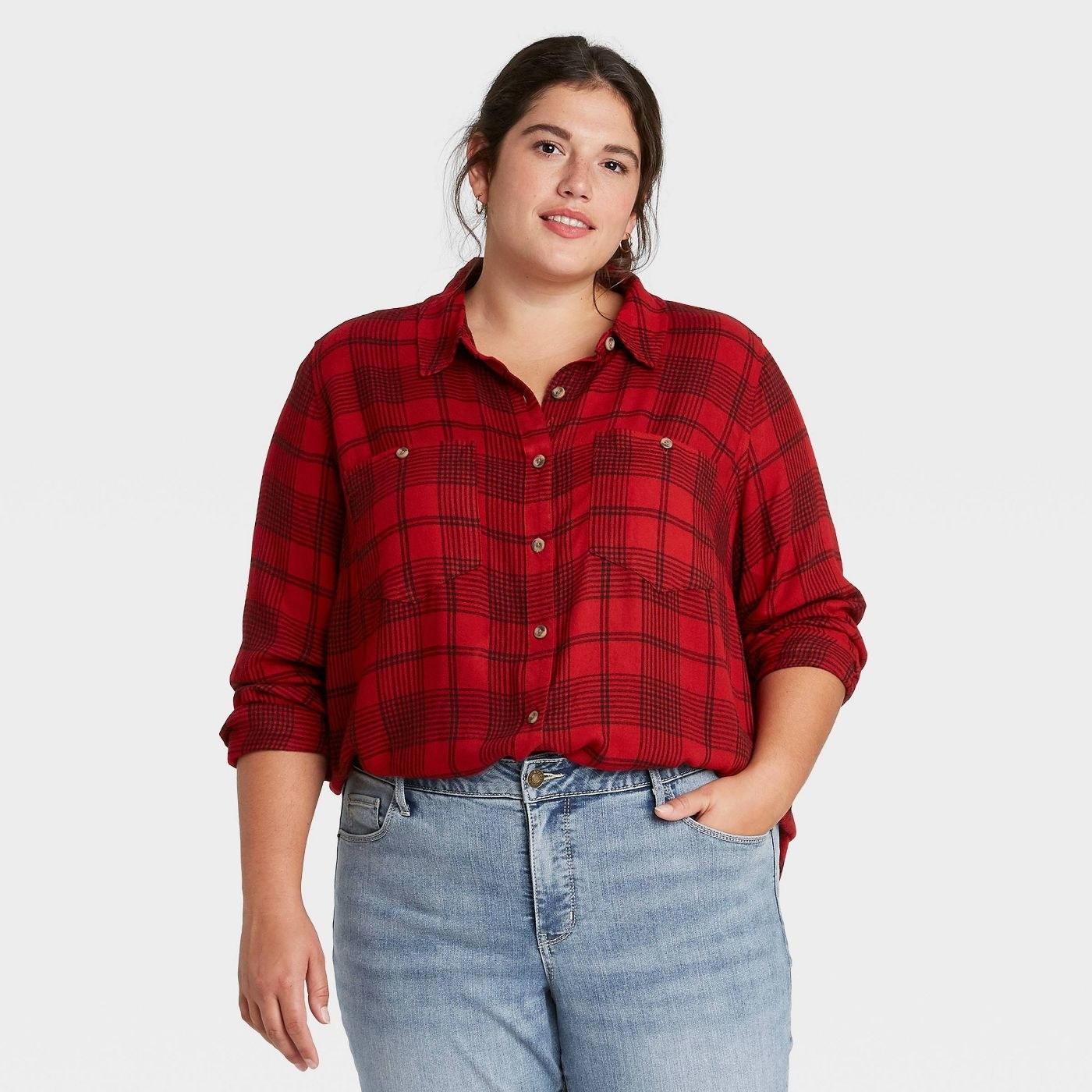 Model in red plaid button-down top