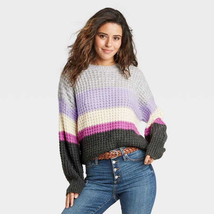 Model in striped crewneck pullover sweater