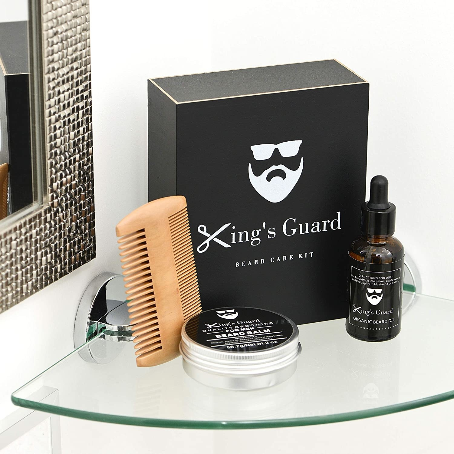 A double sided comb, beard balm, and beard oil together with their gift box