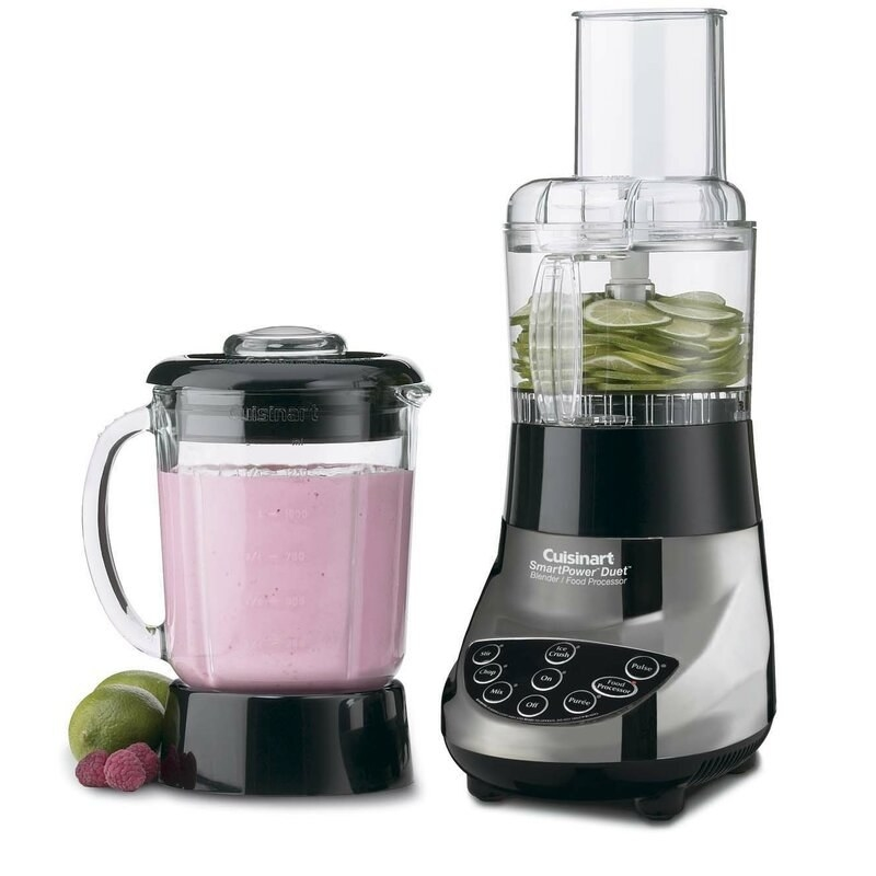 A blender with a pink smoothie inside, and a food processor with limes inside