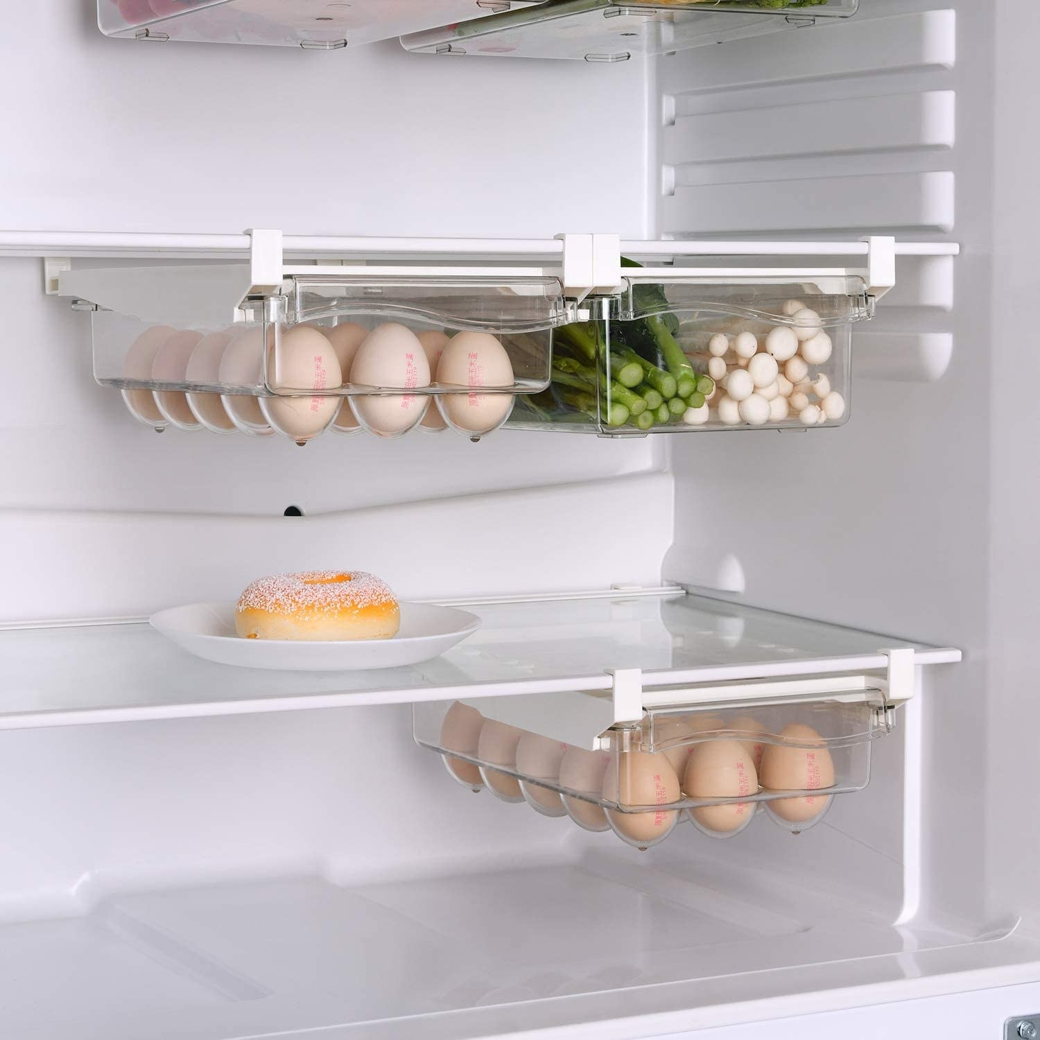 three drawers attached to fridge shelves to hold eggs and other veggies