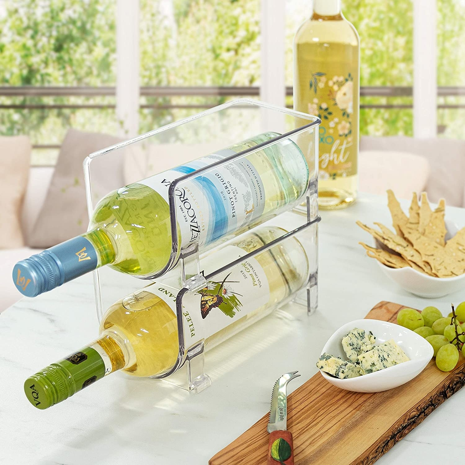 two wine bottles stacked on one another in the organizers
