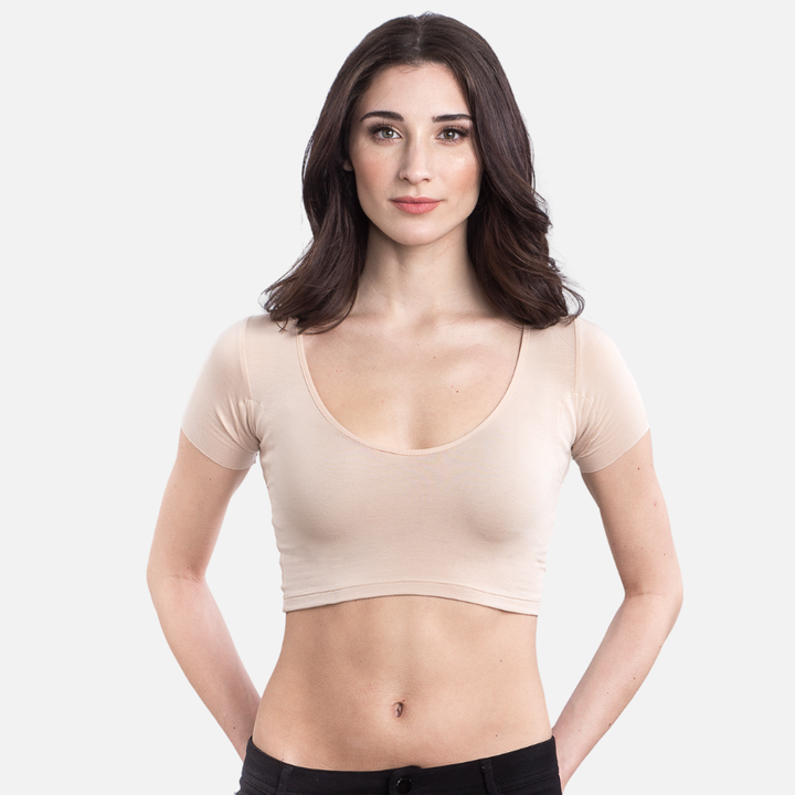 A model wearing a crop top undershirt in Almond with a scoop neckline and short sleeves