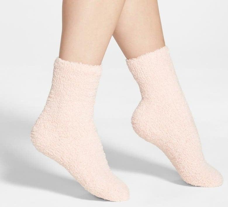 model wearing the pink fuzzy socks
