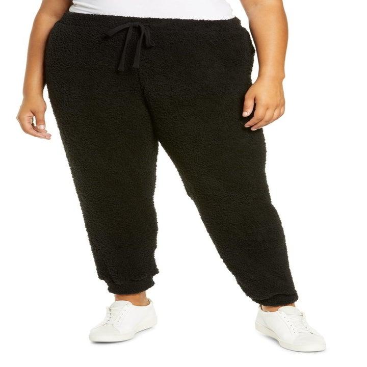 model wearing the black pants