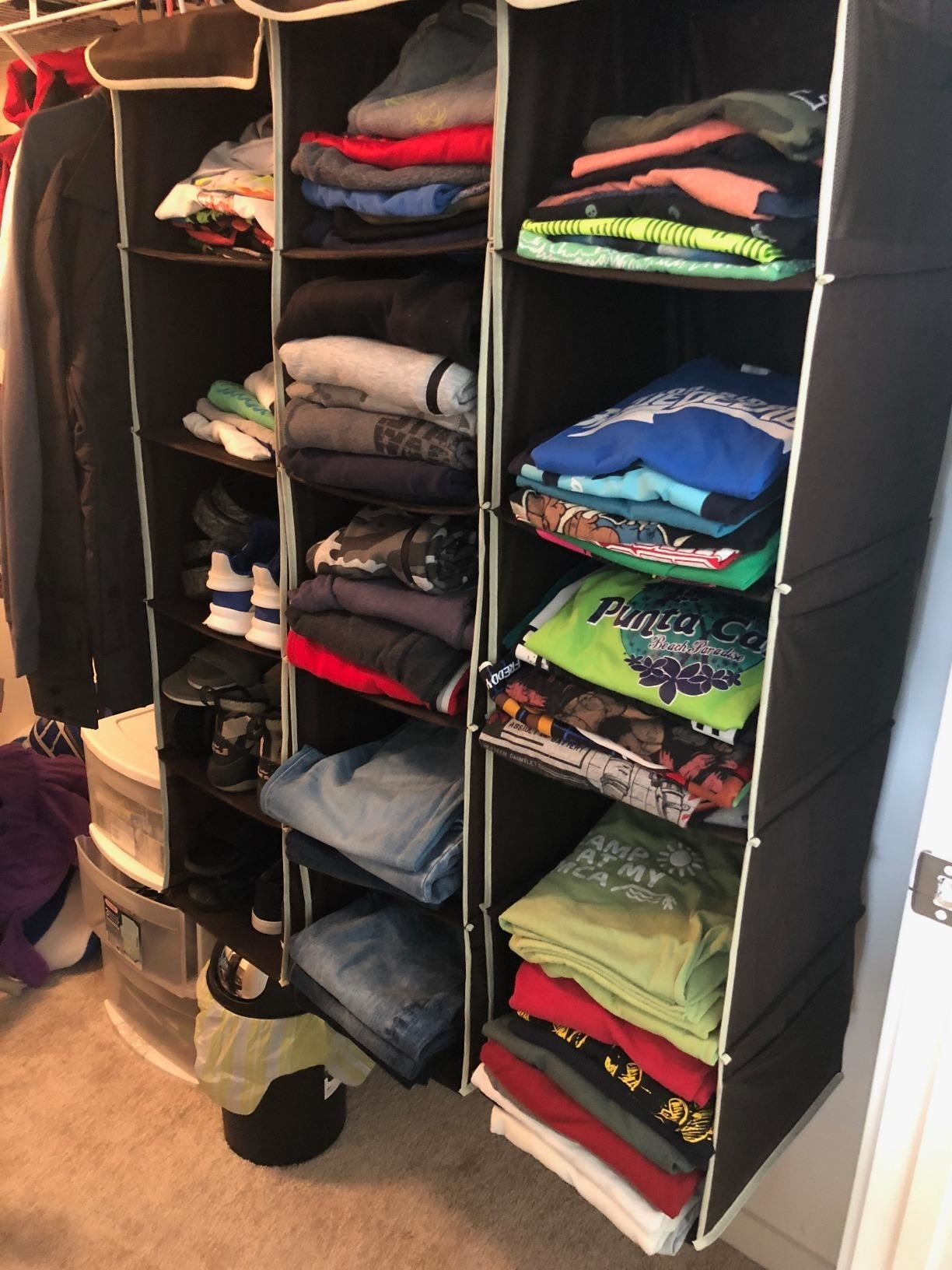 reviewer image of three simple housewares closet organizers hanging in a closet