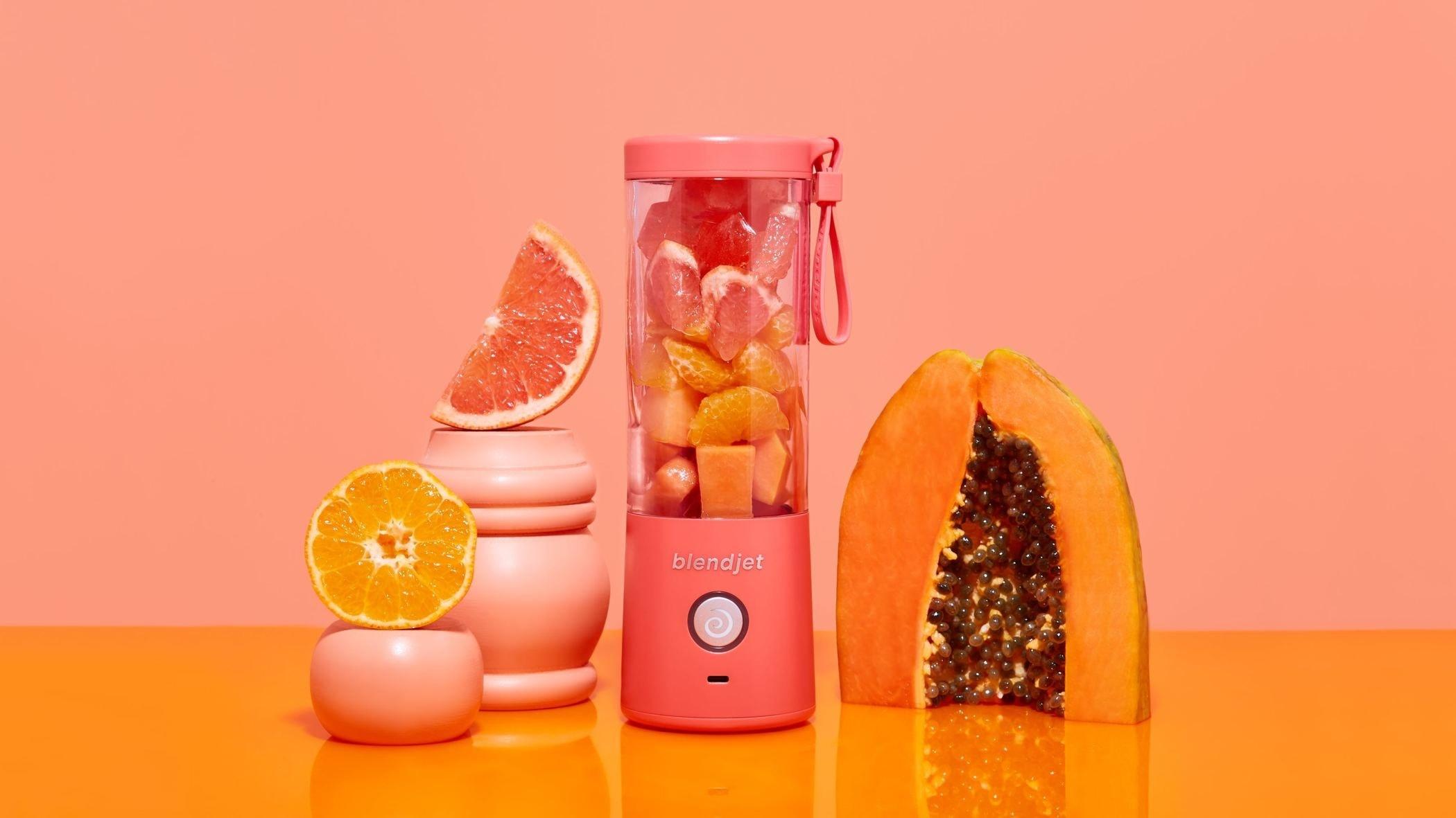 pink blend jet next to fruit