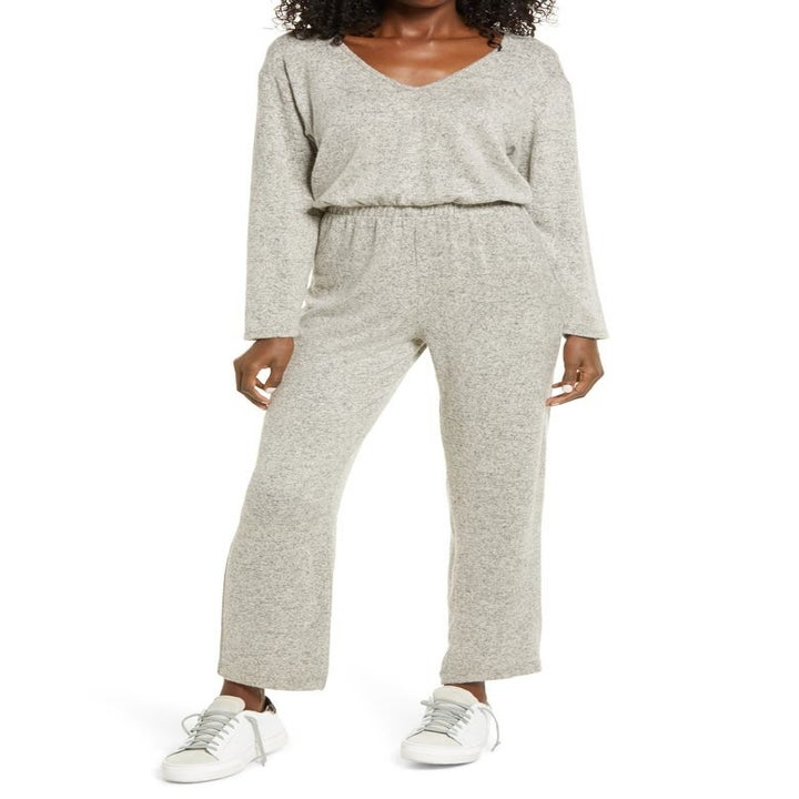 model wearing the light gray jumpsuit