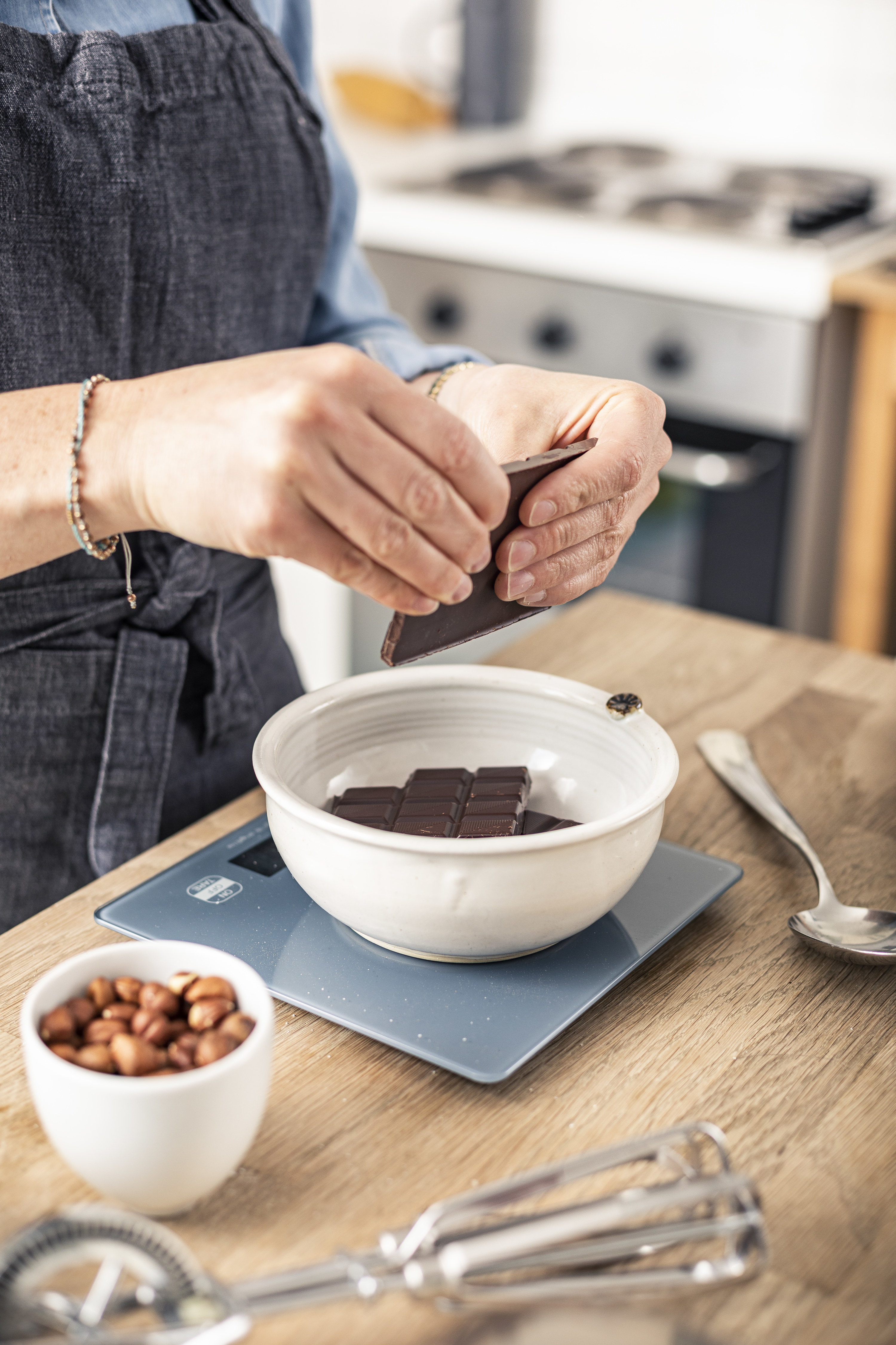 Woman measuring chocolate for a recipe