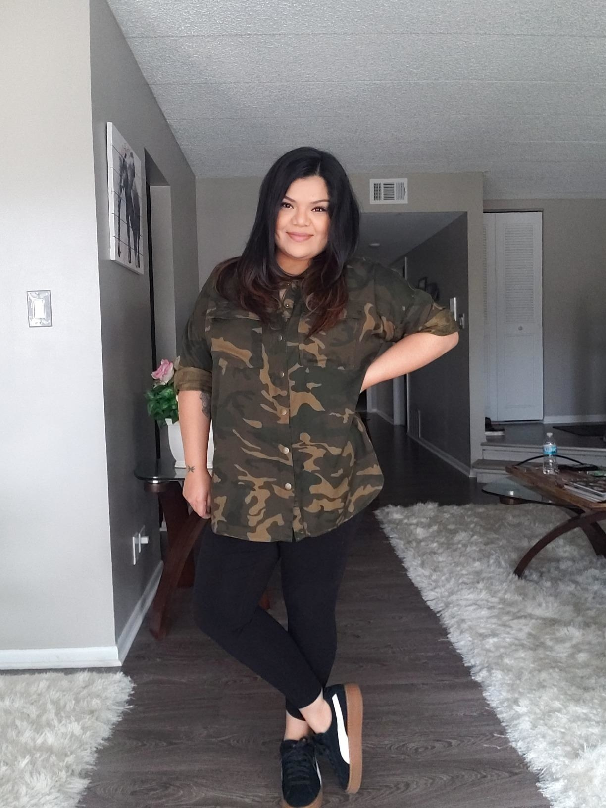 Reviewer wearing the shirt with pockets on the chest in brown and tan camo print