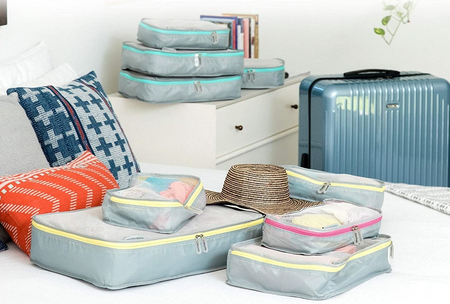 the mimu packing organizers on a bed