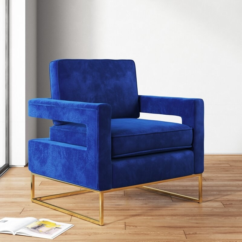 A mid-century modern royal blue square chair with gold square legs