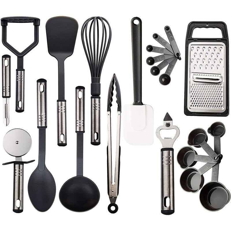 A bunch of cooking utensils that are mostly black with stainless steel handles