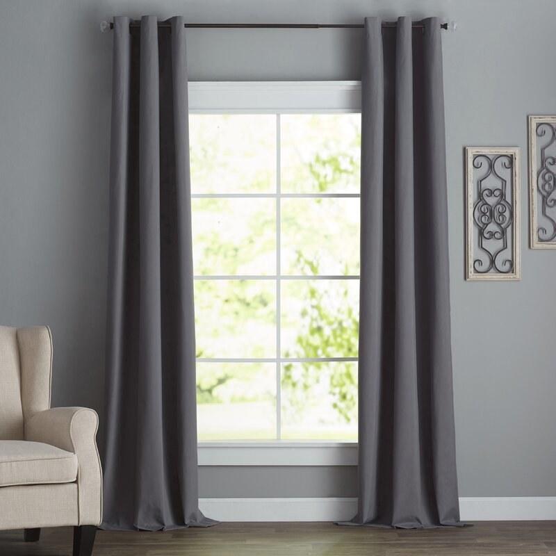 Dark gray curtains around a window with gray walls
