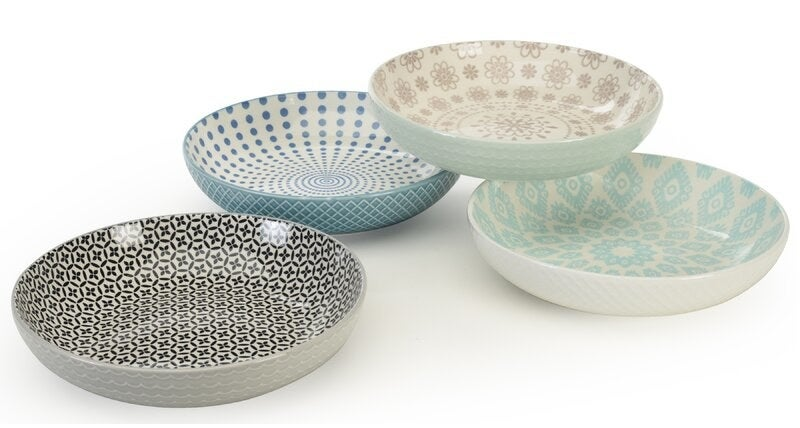 Four salad or pasta bowls with different colored patterns