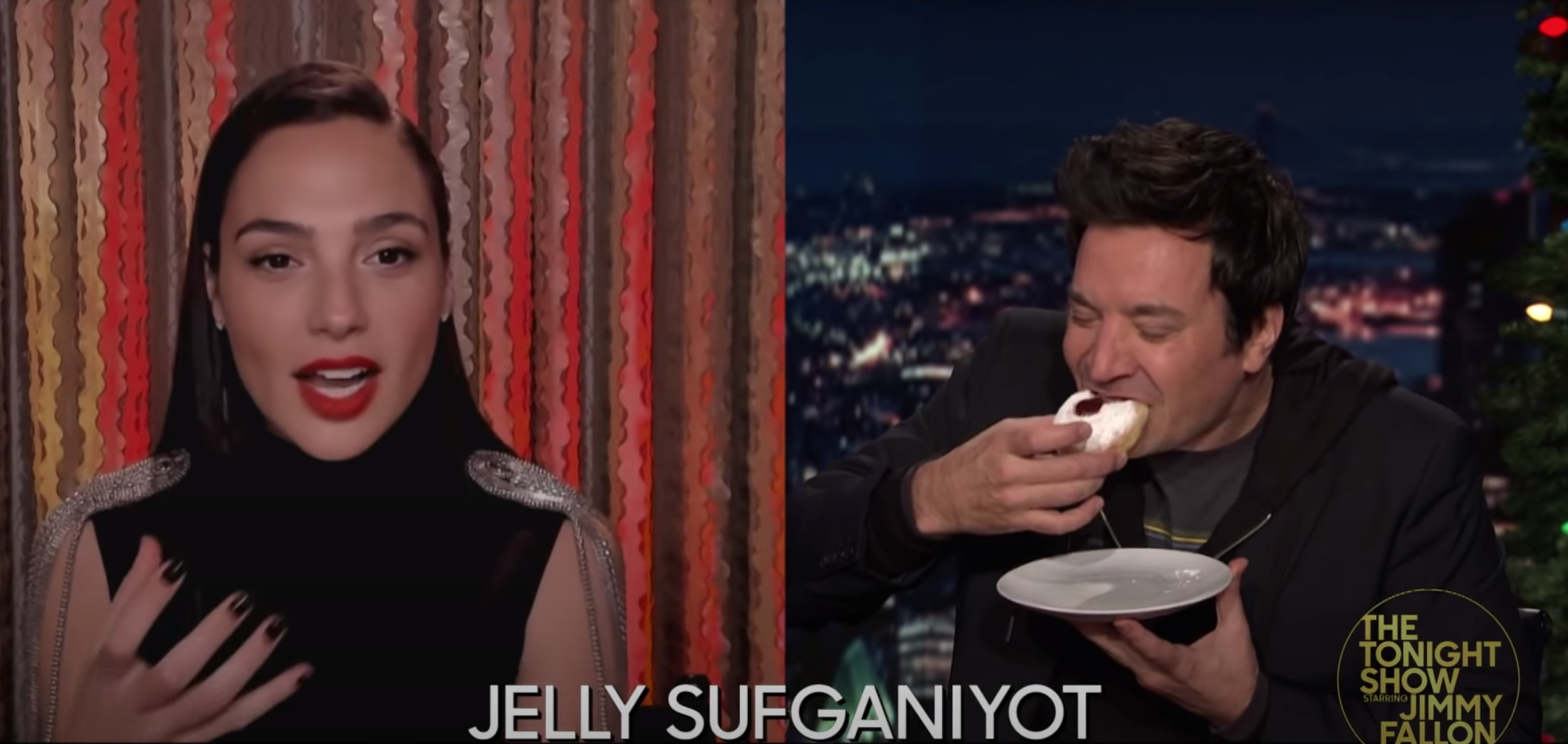 Gal Gadot next to Jimmy Fallon as he eats the jelly sufganiyot