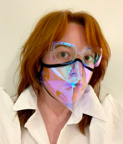 BuzzFeed writer wearing lightweight large glasses in clear multi-colored frame with matching face mask