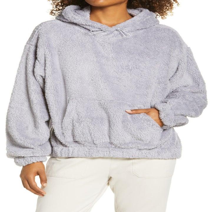 model wearing the lilac hoodie
