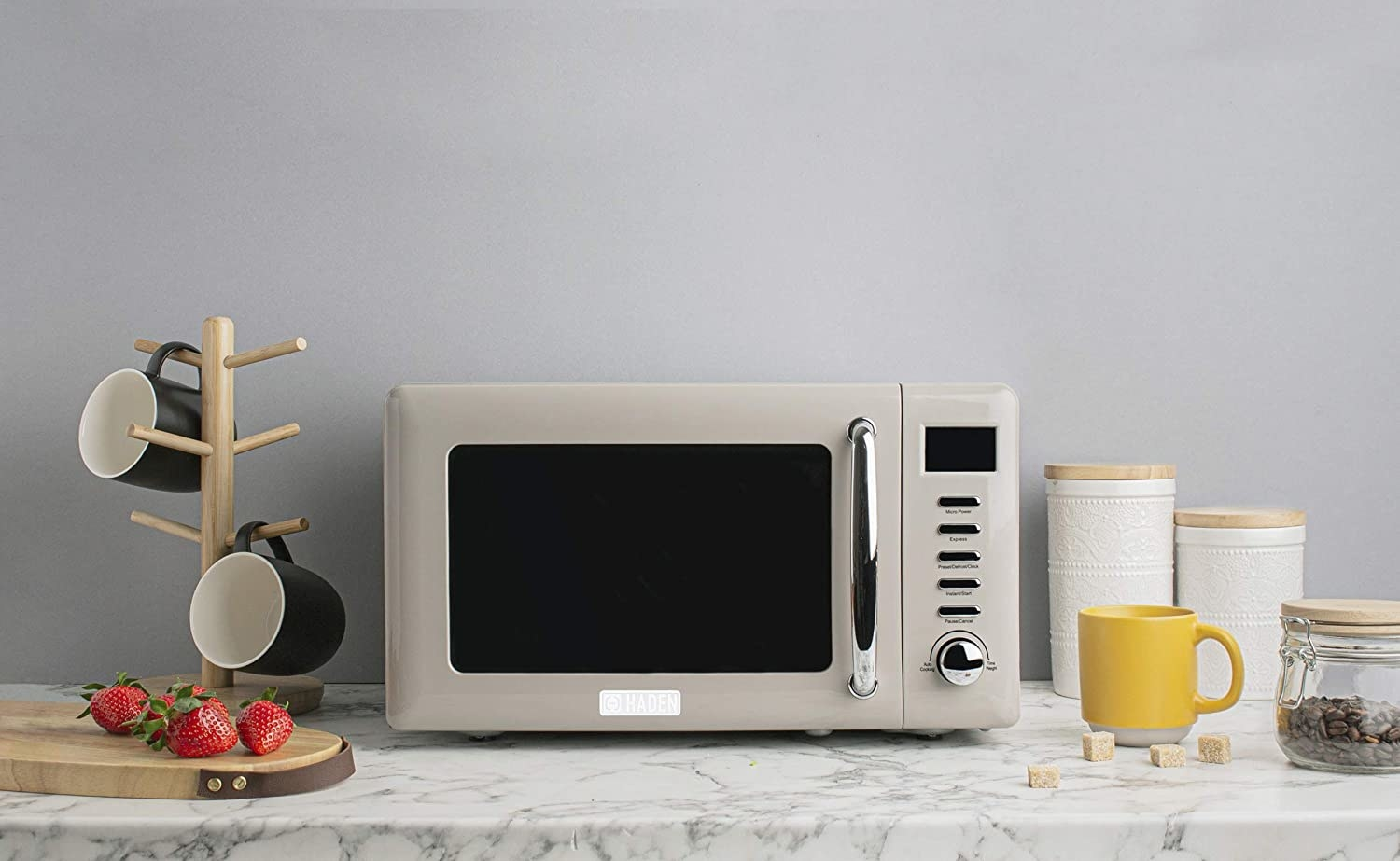 The retro, putty-colored microwave which has one dial and five buttons