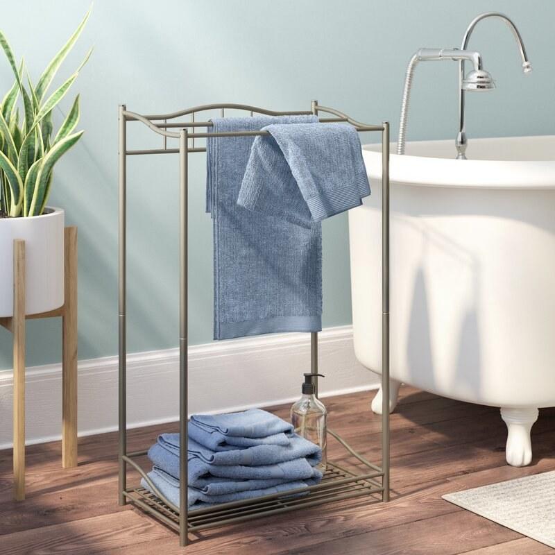 the rebrilliant freestanding towel rack in a bathroom