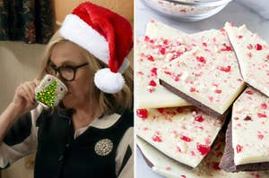 a woman drinking out of a mug wearing a santa hat next to a pile of peppermint bark