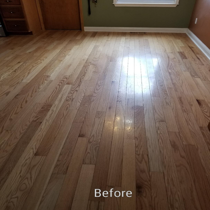 The pale dingy wood floors before using the wood finisher