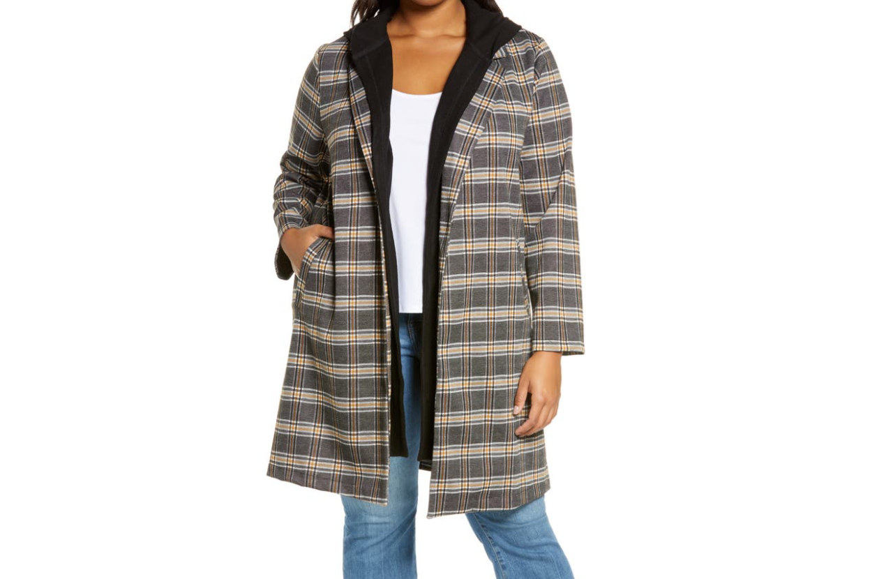 Model wearing the black and brown plaid jacket