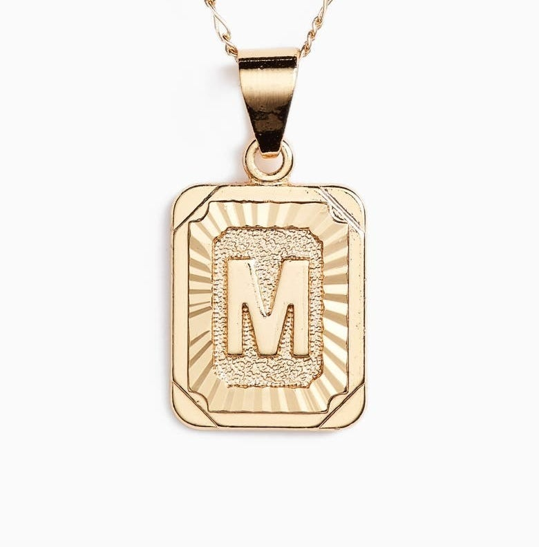 The rectangular pendant with the letter M