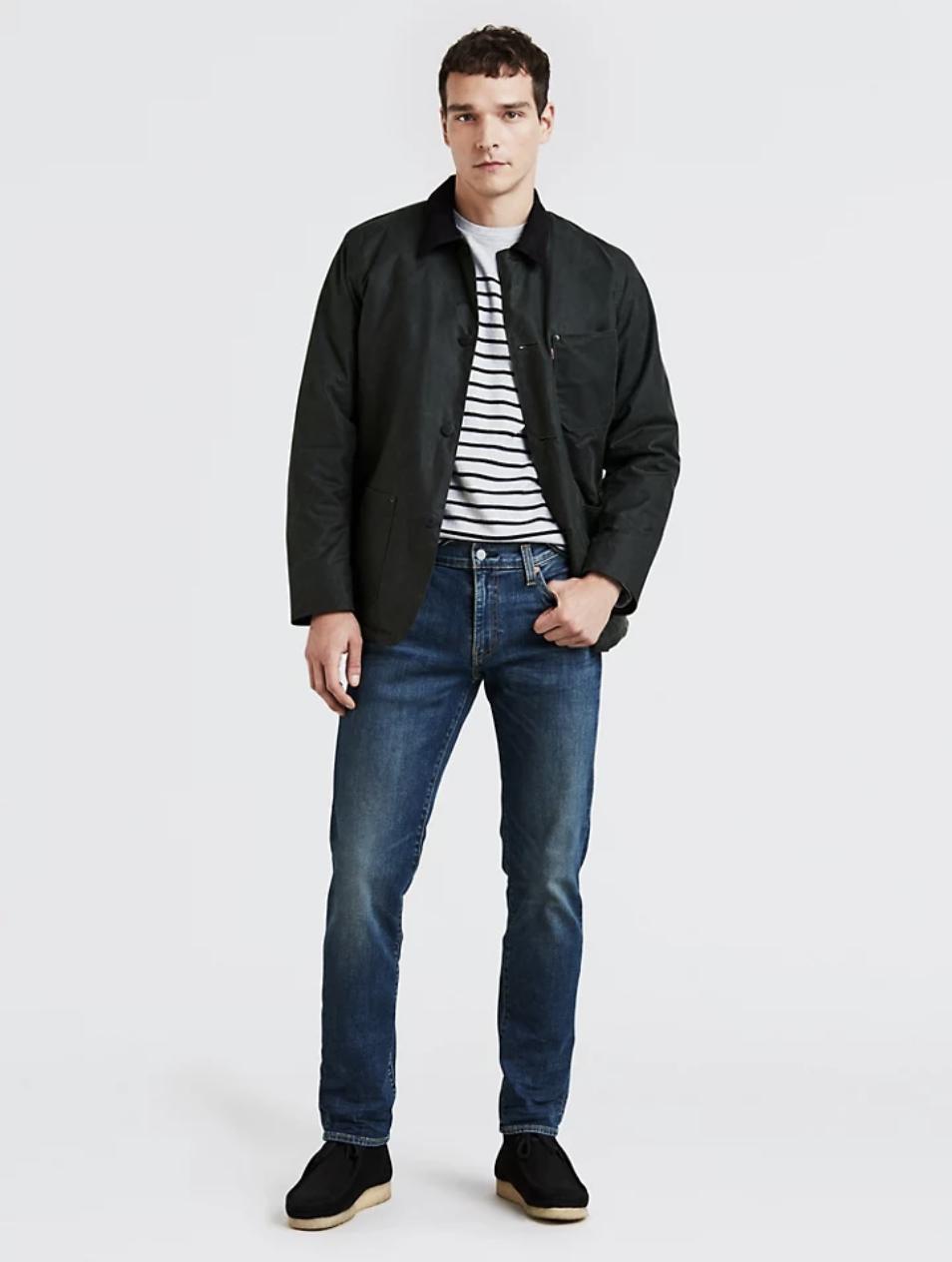 Model in a pair of dark wash boot cut denim jeans