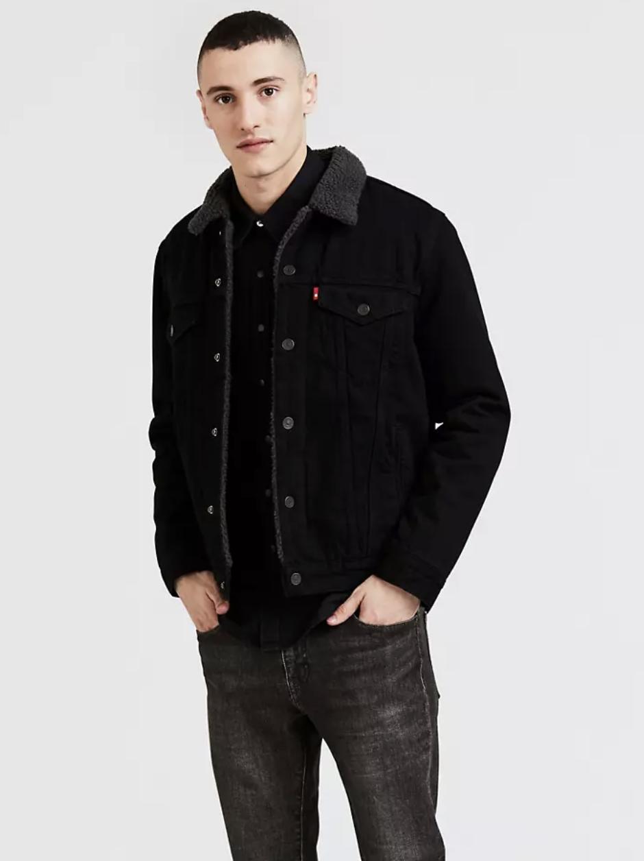 Model in black denim jacket lined with black sherpa