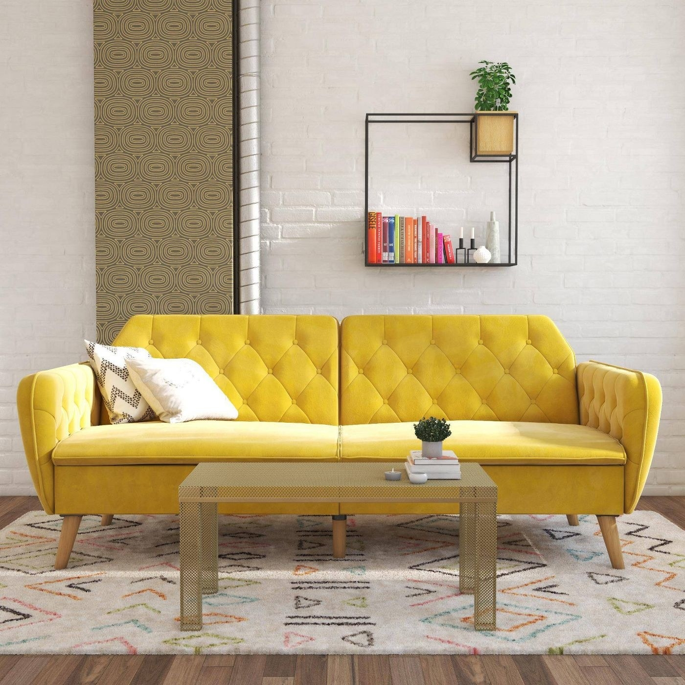 The sofa in yellow shown in a room with a rug and coffee table