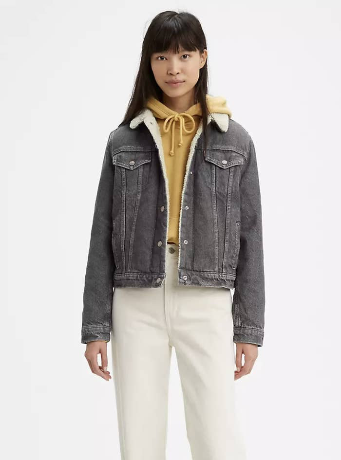 Model in gray trucker jacket with ivory lining