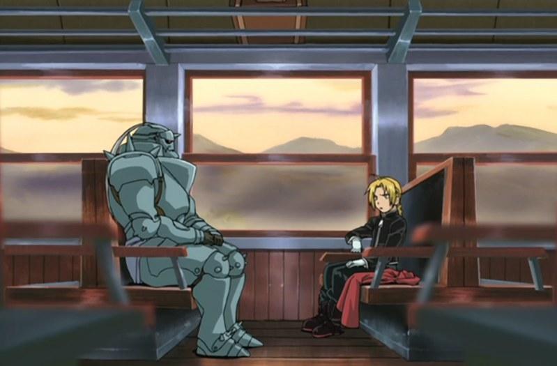 Edward and Alphonse ride a train