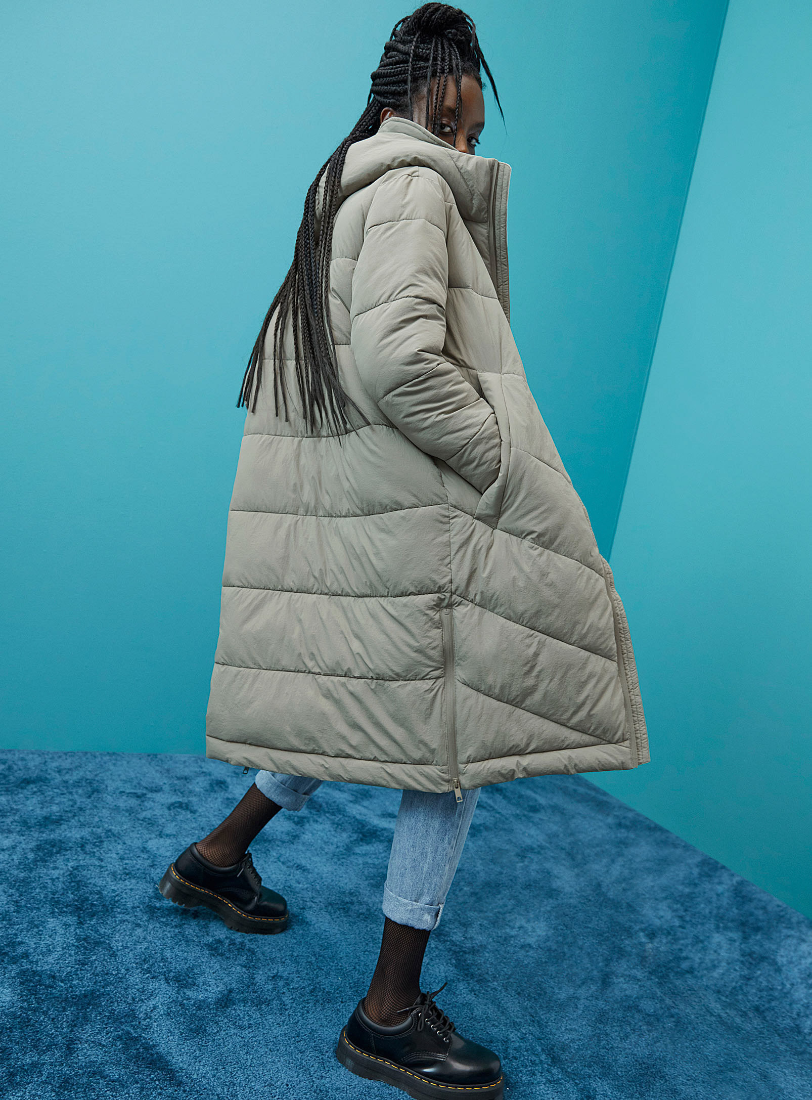 a person wearing a long puffer coat