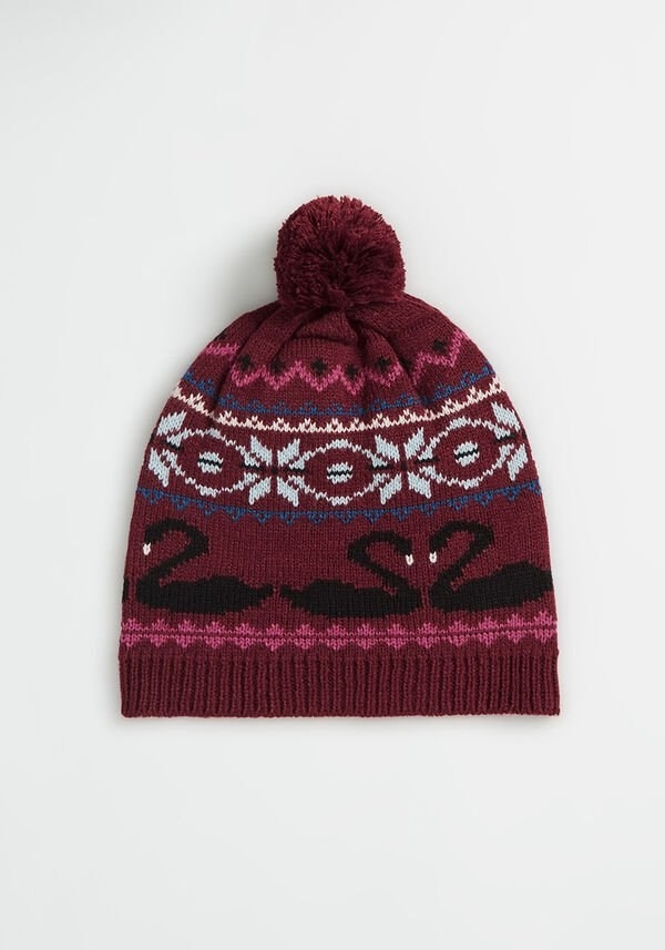 a burgundy hat with black swans printed on it