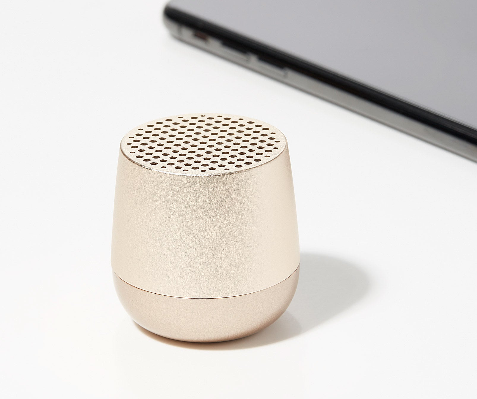 A small Bluetooth speaker on a plain background