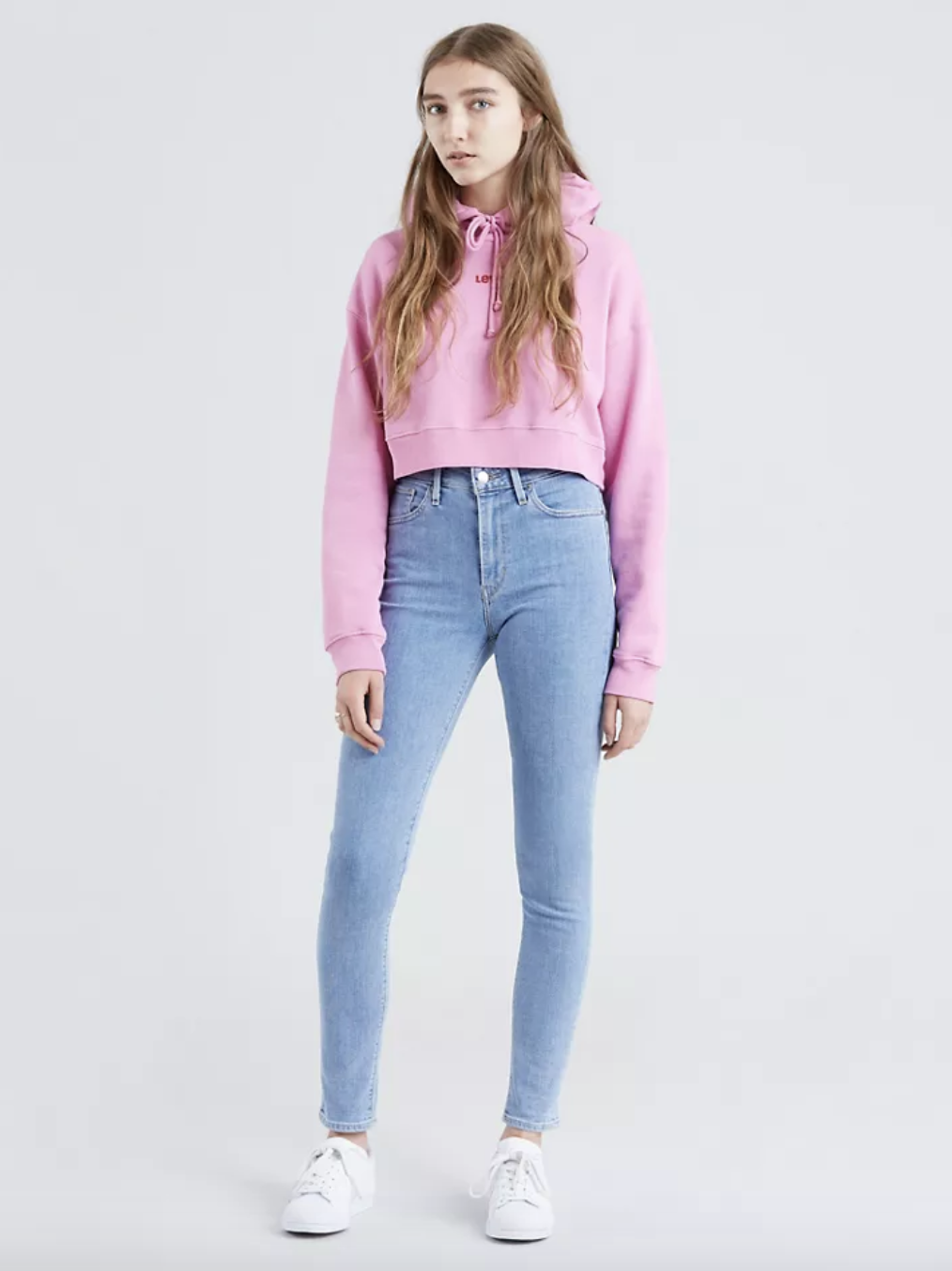 Model in light wash high waisted skinny jeans