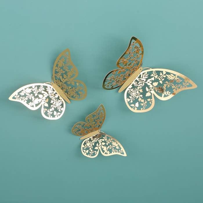 The butterflies stuck to a blue wall