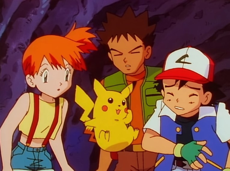 Misty, Brock, and Ash being shocked by Pikachu's behavior