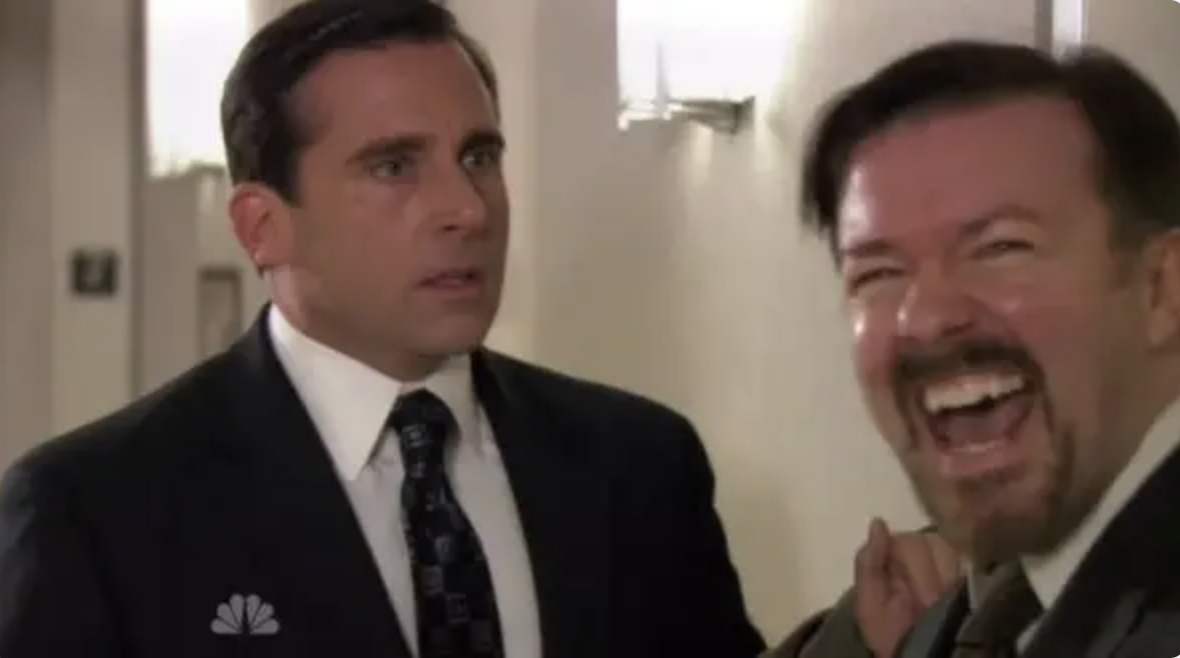 Steve Carrell as Michael Scott and a laughing Ricky Gervais