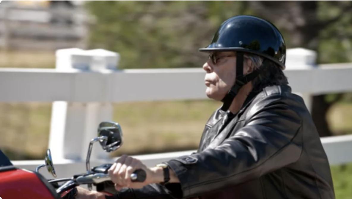 Stephen King riding as motorcycle