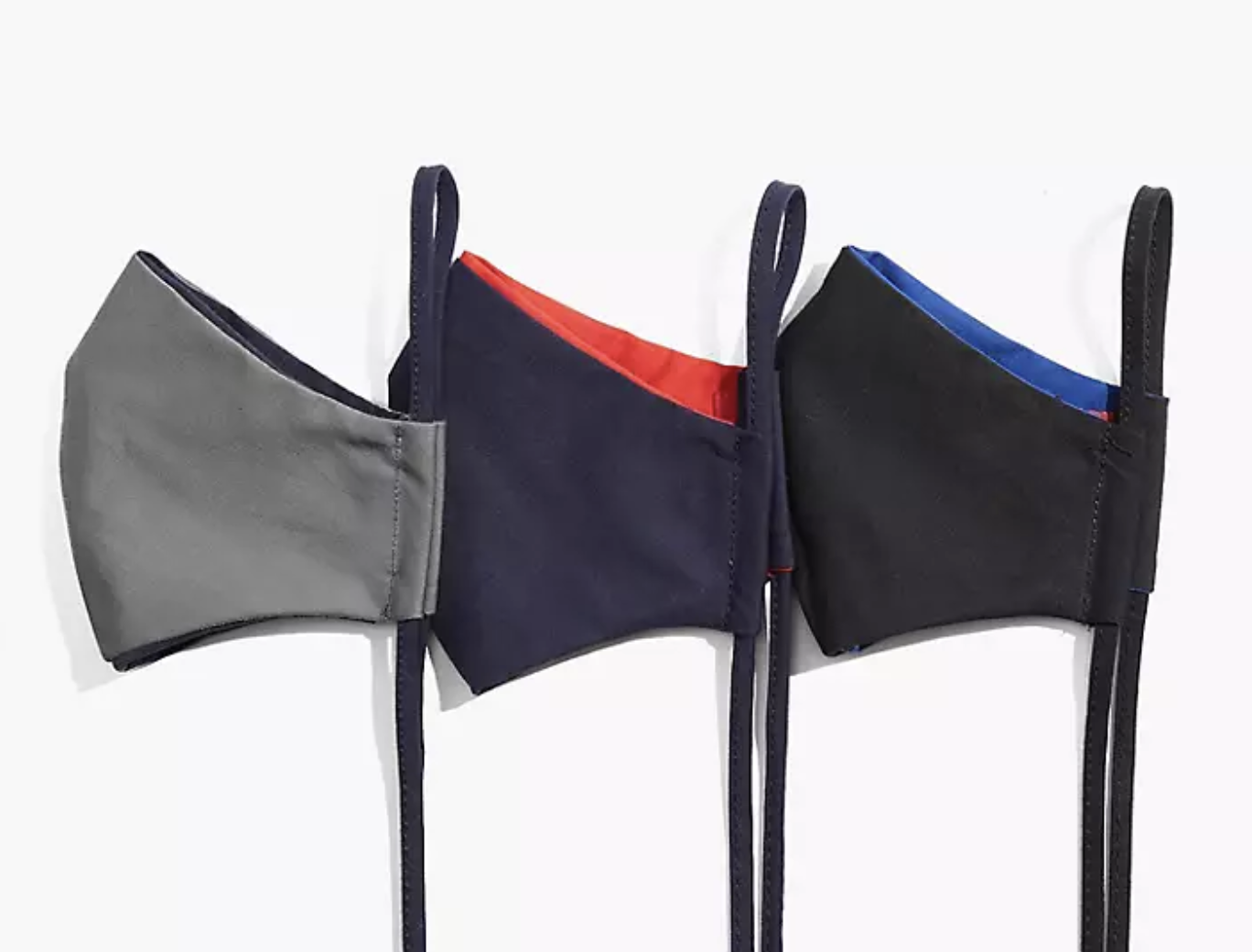 three reversible tie-string face masks in gray, navy, and black