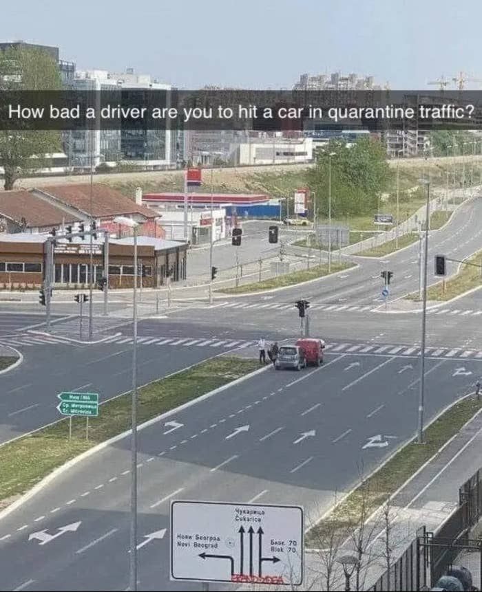 a far away picture of a two car crash during quarantine traffic