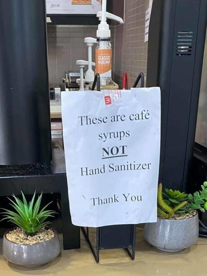 sign on a pump that says this is syrup not hand sanitizer