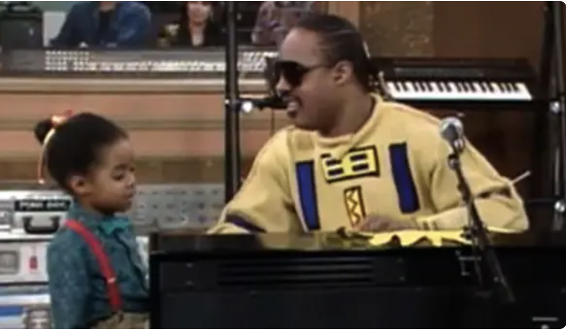 Stevie Wonder and the youngest daughter on the show Rudy